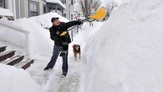 """Snow in the city. The dog is wondering, """"Do I have to wait until this guy is done to get back inside?''"""