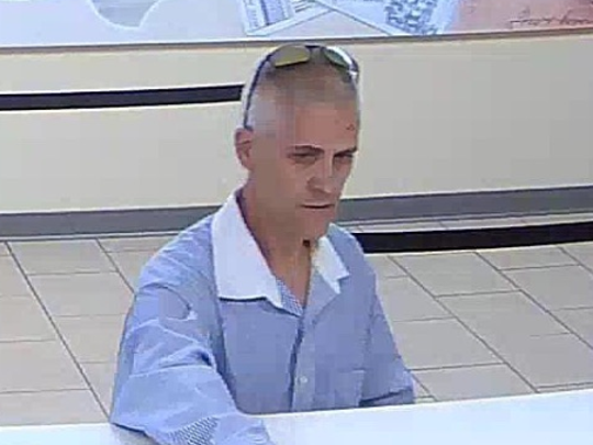 Police are seeking this man in connection with the robbery Monday of a Wells Fargo Bank in Westmont.