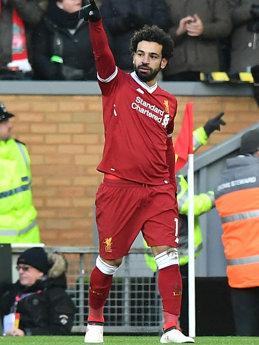 Liverpool's Mohamed Salah celebrates scoring his side's first goal during the English Premier League soccer match between Liverpool and Watford at Anfield, Liverpool, England, Saturday, March 17, 2018. (Anthony Devlin/PA via AP)