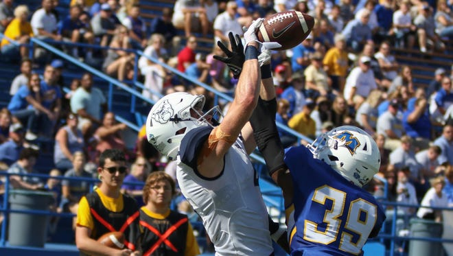 Butler's Pace Temple (left) goes up for a grab in the Bulldogs' win over Morehead State on Saturday.