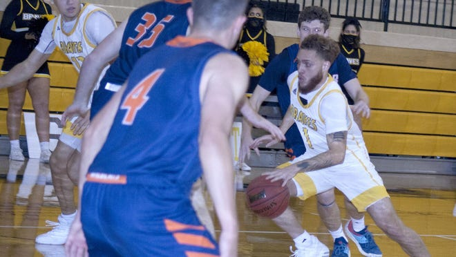 Ottawa University senior guard Perry Carroll, a former Ottawa High School standout, made an immediate impact for the Braves, averaging nearly 13 points a game.