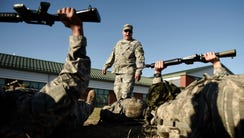 Army National Guard Sgt. 1st Class Daniel Ford shouts