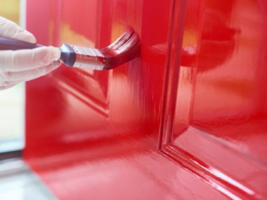 A vibrant front door with updated hardware won't be overlooked during your home showing, and if you're confident with your painting skills, you can do it yourself.