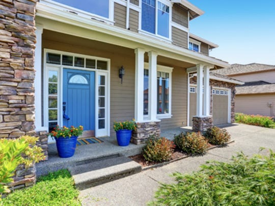 A clean front porch with a freshly painted front door will make the best first impression before potential buyers visit for a showing.