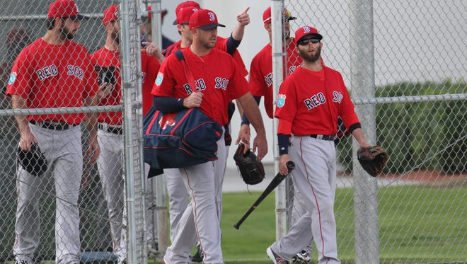 Dustin Pedroia, along with other members of the Boston Red Sox take the field during their first full squad practice at JetBlue Park on Wednesday.