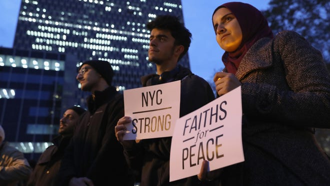 People take part in a vigil for those killed the day before in New York, on Nov. 1, 2017. The Council on American-Islamic Relations organized the event a day after the attack in lower Manhattan that killed eight people.