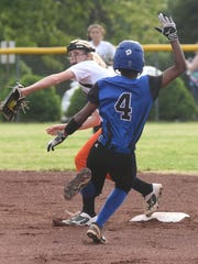 Viola shortstop Keyaira Moore attempts to turn a double