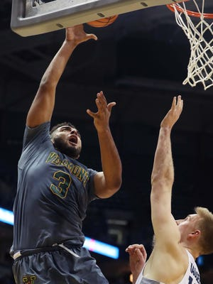 Vermont Catamounts forward Anthony Lamb (3) scores against Marquette Golden Eagles guard Sam Hauser (10) during Marquette's  91-81 win over Vermont  in the men's basketball game at the BMO Harris Bradley Center in Milwaukee, Wisconsin, Tuesday, December 05, 2017.  Milwaukee Journal Sentinel photo by Rick Wood/RWOOD@JOURNALSENTINEL.COM