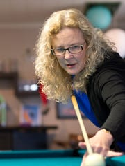 Vicki Paski, Grand Ledge business woman and community leader, is also a professional, award-winning billiards player.