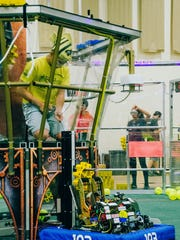 Billy Albert, Mount Olive High School Beta Team 193 member, competes in a 2017 FIRST Robotics Competition as part of the drive team. Beta will be among 40 robotics teams competing at the Mount Olive District Event from March 9-11.