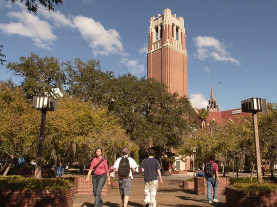 University of Florida students walk through Turlington Plaza which is situated near the campus icon, Century Tower.