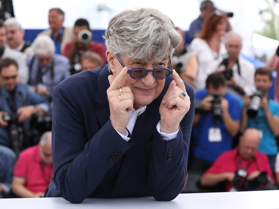 Director Wim Wenders poses for photographers during
