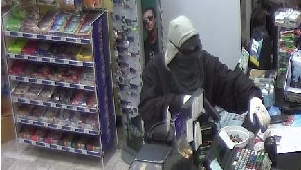 Store camera sees thief holding up Gulf gas station in Fishkill.