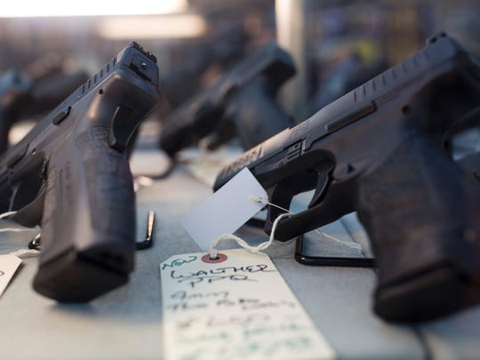 Handguns are for sale at a gun shop in Merrimack, N.H.