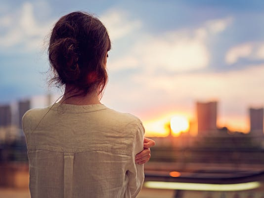 Young girl is watching sunset over Tokyo
