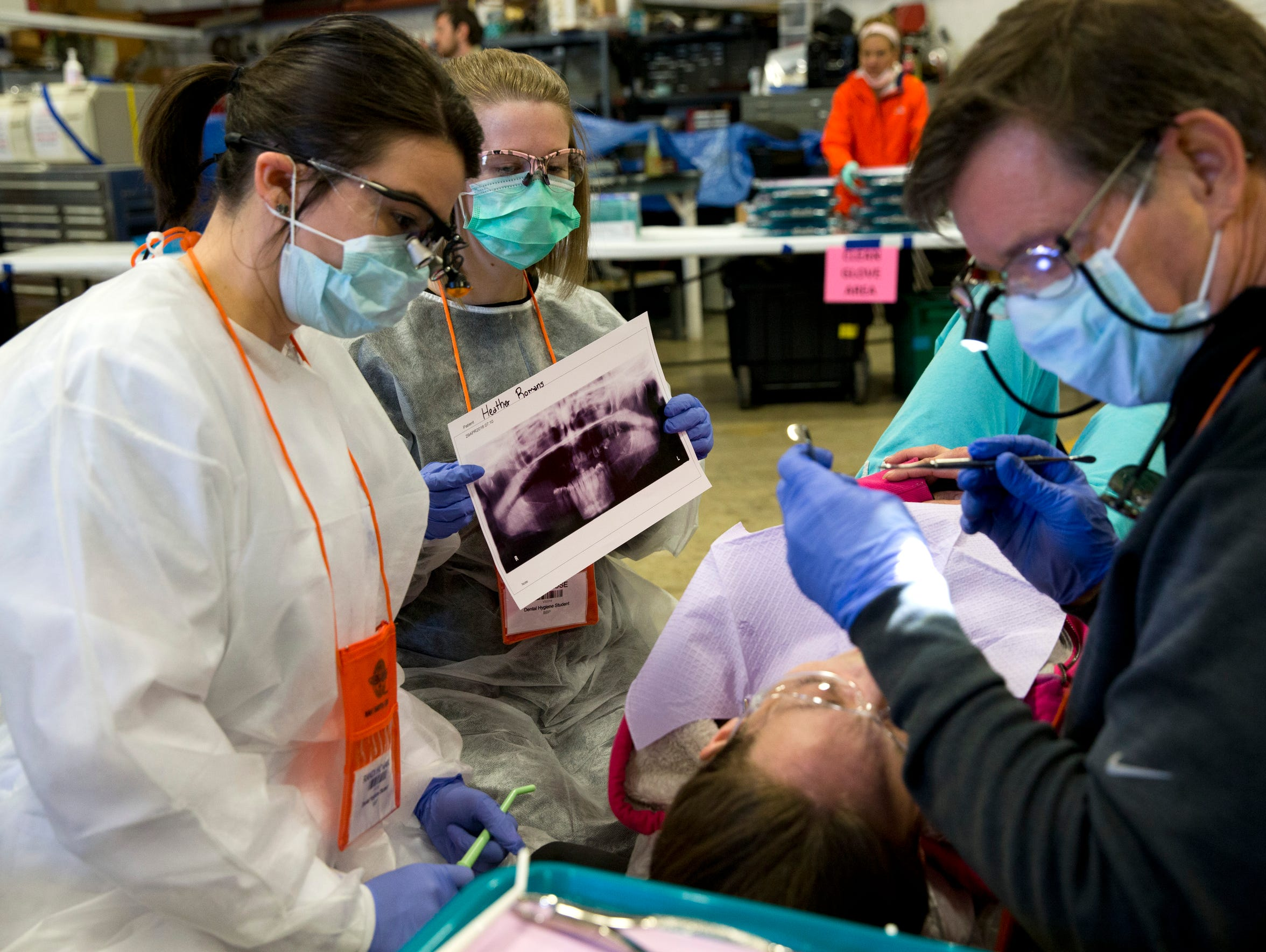 Randi Honaker, left, and Kayla Rose, volunteer dental