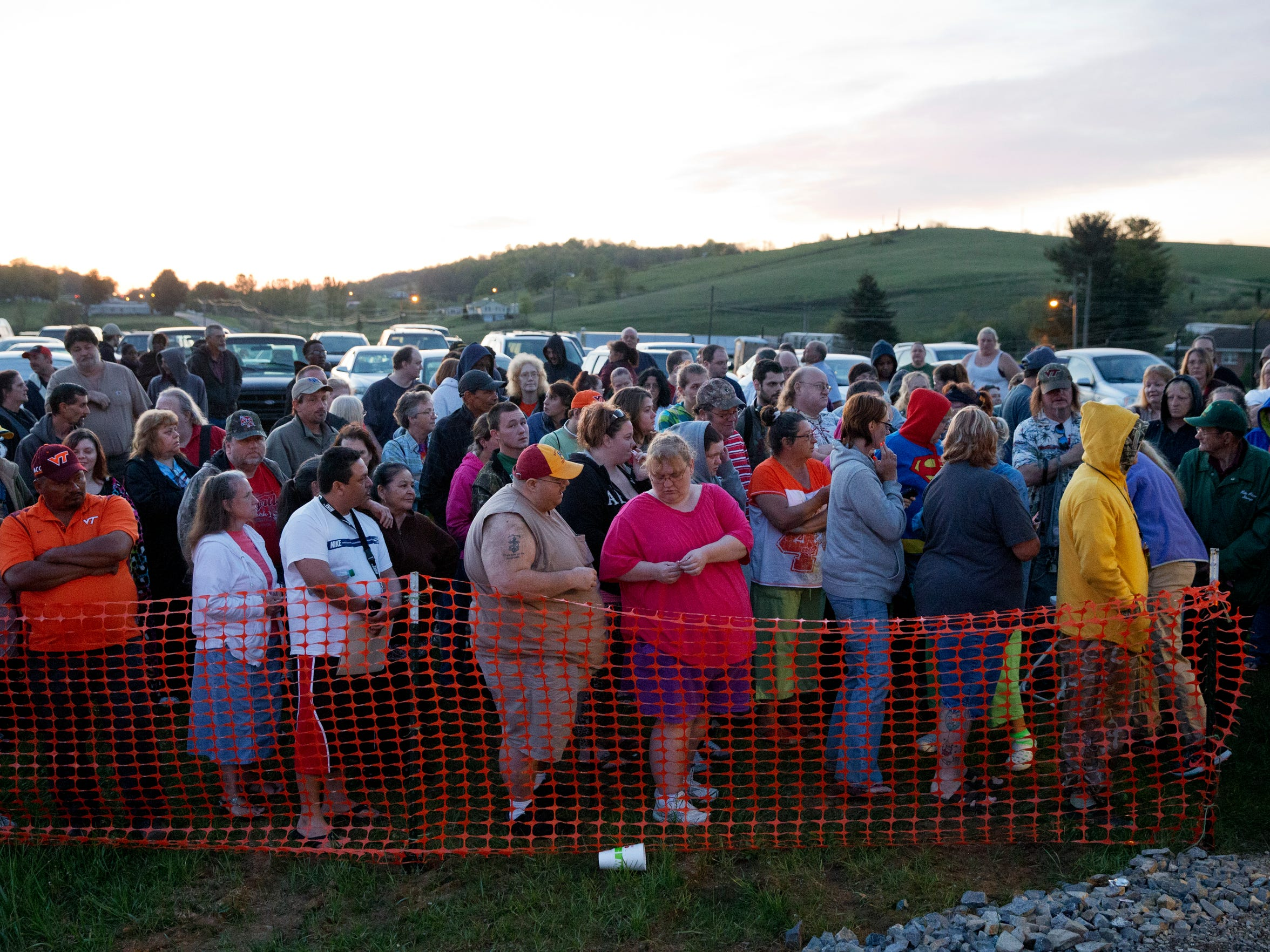 Hundreds of people line up in the early morning to