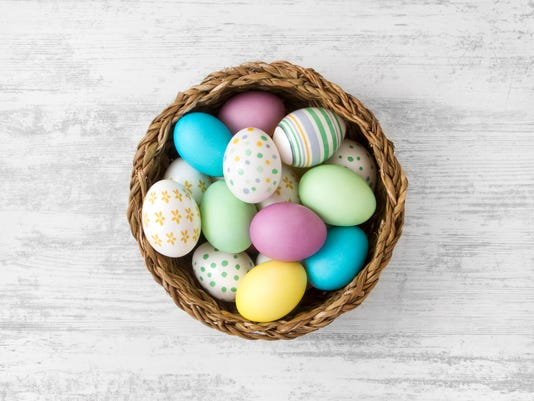 Easter Eggs on White Wooden Table Background