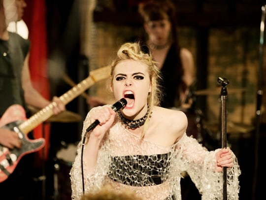 "Zan (Elle Fanning) performs a punk song in ""How to"