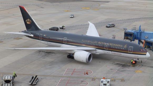 A Royal Jordanian Boeing 787 aircraft pulls up to a