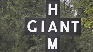 The Red's Giant Hamburg replica sign is in place in the Birthplace of Route 66 Roadside Park on College Street. It went up Monday.