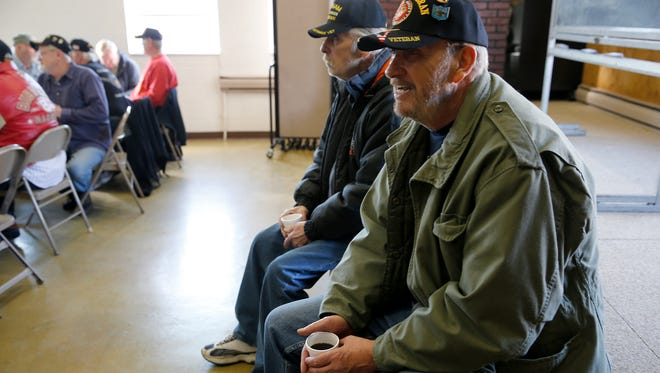 Vernon Brooks, of who served in the Marine Corps veteran and Ron Huffman of Collinsville, background, during their weekly gathering of the Veterans Social Command, support group at Middletown. Thursday January 21, 2016.