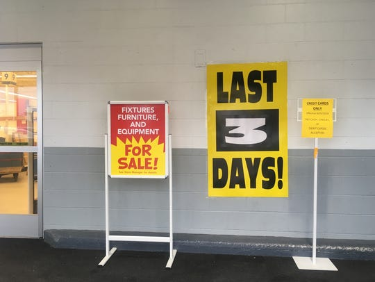 Signs in the front of the Greenwood Toys R Us store