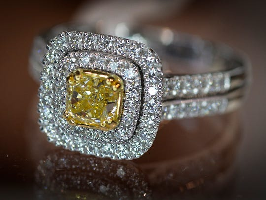A yellow diamond ring set in 14kt white gold is shown in a photo taken in 2015 at D.J. Bitzan Jewelers in Waite Park.