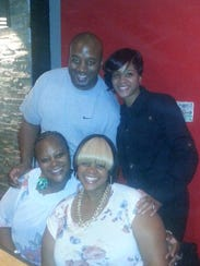 Photo of Tracy Henton-Williams (front left) with her