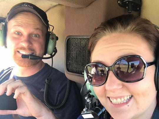 Stephen Marr and his girlfriend, Tiffany Guerin, on the helicopter where they got the shot of SpaceX's drone ship.