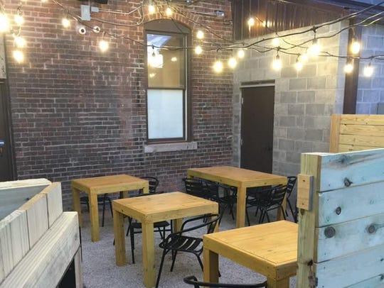 A patio sits behind east side cider maker Ash & Elm