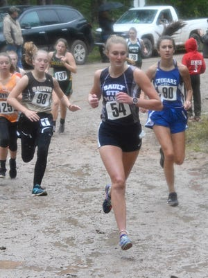 Sault High's Haleigh Knowles (number 54) is pictured during an early season cross country race this past fall. Knowles is a finalist for the MHSAA Scholar-Athlete Award.