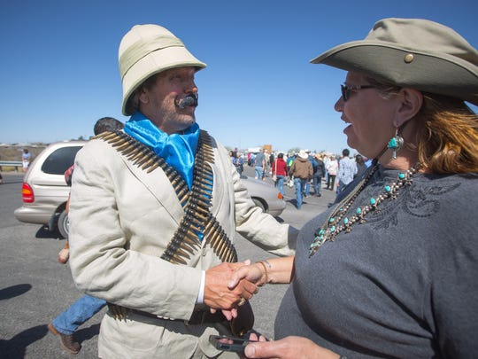 Philip Vasquez, visiting from Fort Worth and dressed as Pancho Villa shakes the hand of a spectator in Columbus, NM, at the centennial commemoration of Villa's raid on the city, March 12, 2016.