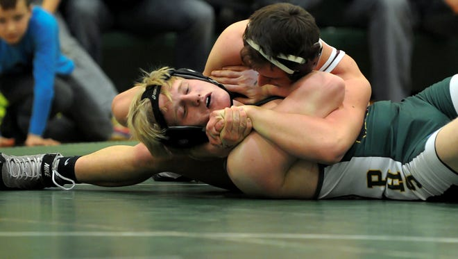 Delton Kellogg's Cameron Hudson (top) and the Panthers will compete at the MHSAA Team Wrestling Finals on Friday