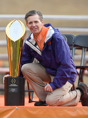 Asheville native and Hendersonville High alumnus Don Munson poses with the Clemson football team's national championship trophy. Munson serves as play-by-play announcer for radio broadcasts of the Tigers' games.
