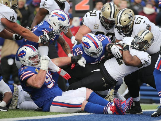 Saints running back Mark Ingram scores one of his two