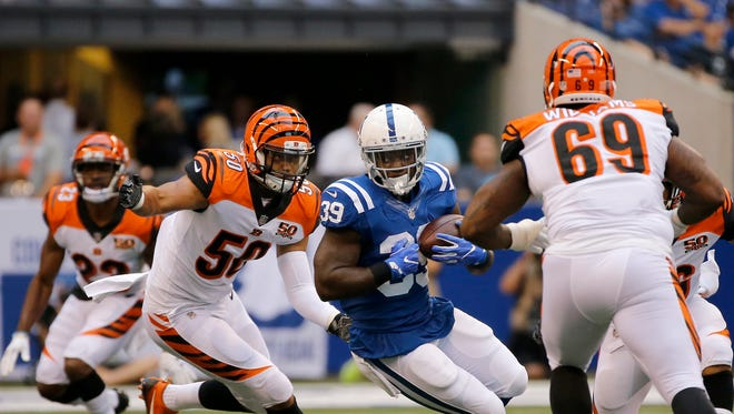 Indianapolis Colts defensive back Lee Hightower (39) spins ahead of Cincinnati Bengals linebacker Jordan Evans (50) on a carry in the first quarter of the NFL Preseason Week 4 game between the Indianapolis Colts and the Cincinnati Bengals at Lucas Oil Stadium on Aug. 31.