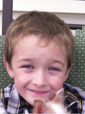 Donovin Johnston, 9, is 4-feet-9 and 90 pounds, with light brown hair.