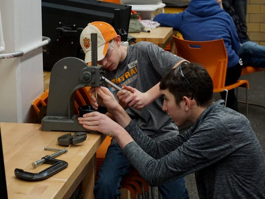 Students work during the FIRST Robotics season kick