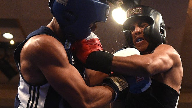 Nevada's JJ Mariano, left, lands a blow against Air Force's Pedro Barrientes during their 147 pound bout at the . NCBA Western Regional Championships at the Eldorado Hotel Casino in Reno on Saturday.