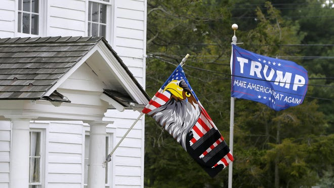 Trump flags fly and a Trump sign hangs on the West Long Branch home of Joseph Hornick.