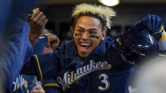 Brewers shortstop Orlando Arcia celebrates with his teammates after hitting a solo home run in the sixth inning.