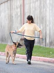 Michelle McShane, of West Palm Beach, Florida, walks