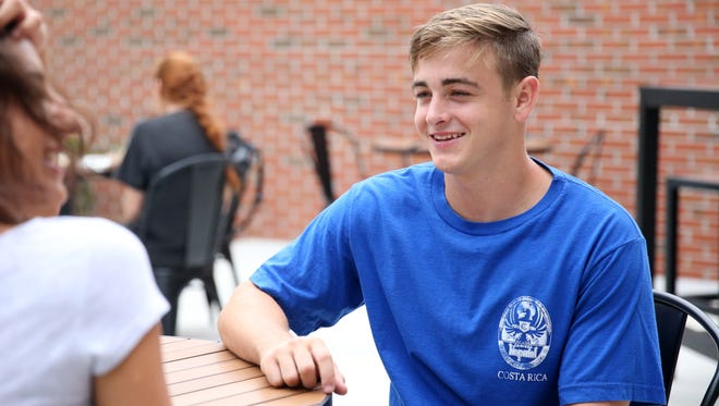 Freshman Evan Knapp sits outside at 1851, Florida State's newest food-court-style dining facility, during the venue's first day of business Monday.