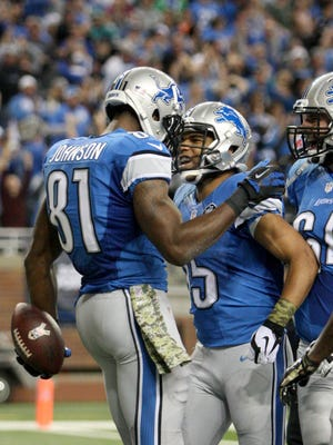 Detroit Lions Calvin Johnson celebrates his touchdown with Golden Tate