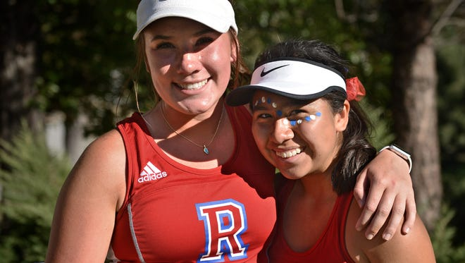 Reno High's tennis doubles partners Jill Rovetti, left, and Jazlyn Parker pose for a photo at the Caughlin Ranch Athletic Club on Oct. 6.