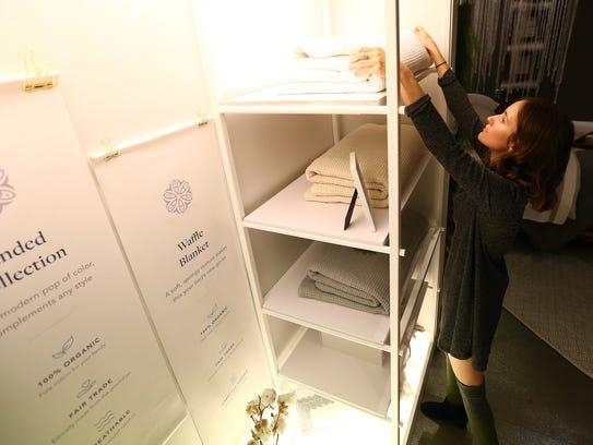 Sales Supervisor Rachel Sutherland arranges bedding