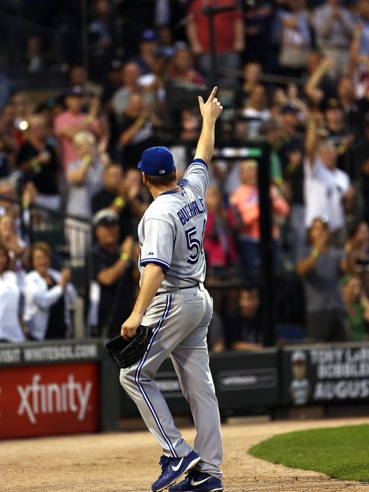 Toronto Blue Jays and former Chicago White Sox starting pitcher Mark Buehrle waves to crowd after being pulled in the sixth inning in a baseball game in Chicago on Saturday, Aug. 16, 2014. (AP Photo/Charles Cherney)
