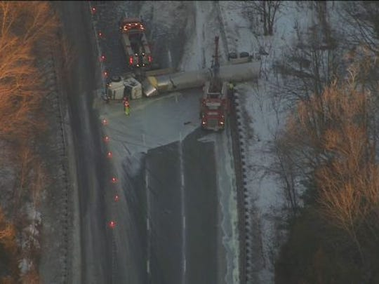 Overturned tractor-trailer near I-80 in Hope Township.~