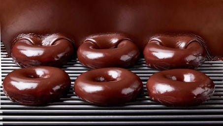 Krispy Kreme's original glazed doughnut will be smothered in a rich chocolate glaze for the solar eclipse on Aug. 21.